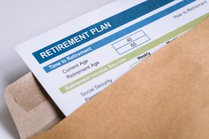 Retirement Planning letter in brown envelope opening